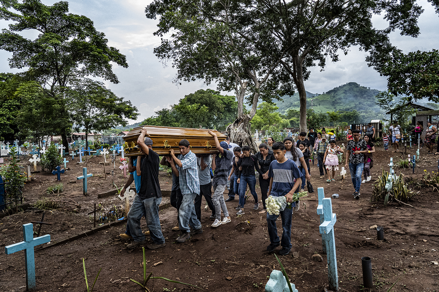 "A funeral delegation carries the coffin of Douglas Rivera—known as ""Cara de Malo"" or ""Face of Evil""—in Chapeltique Municipal Cemetery on Sept. 27. The 22-year-old was one of four members of MS-13 killed by the Special Police Tactical Unit while hiding in a jungle camp in the municipality of Moncagua."