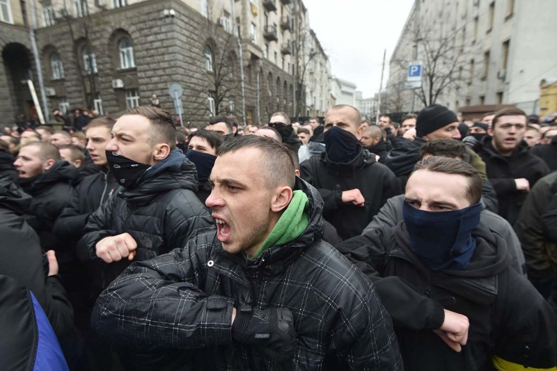 Activists of the Ukrainian far-right party National Corps salute