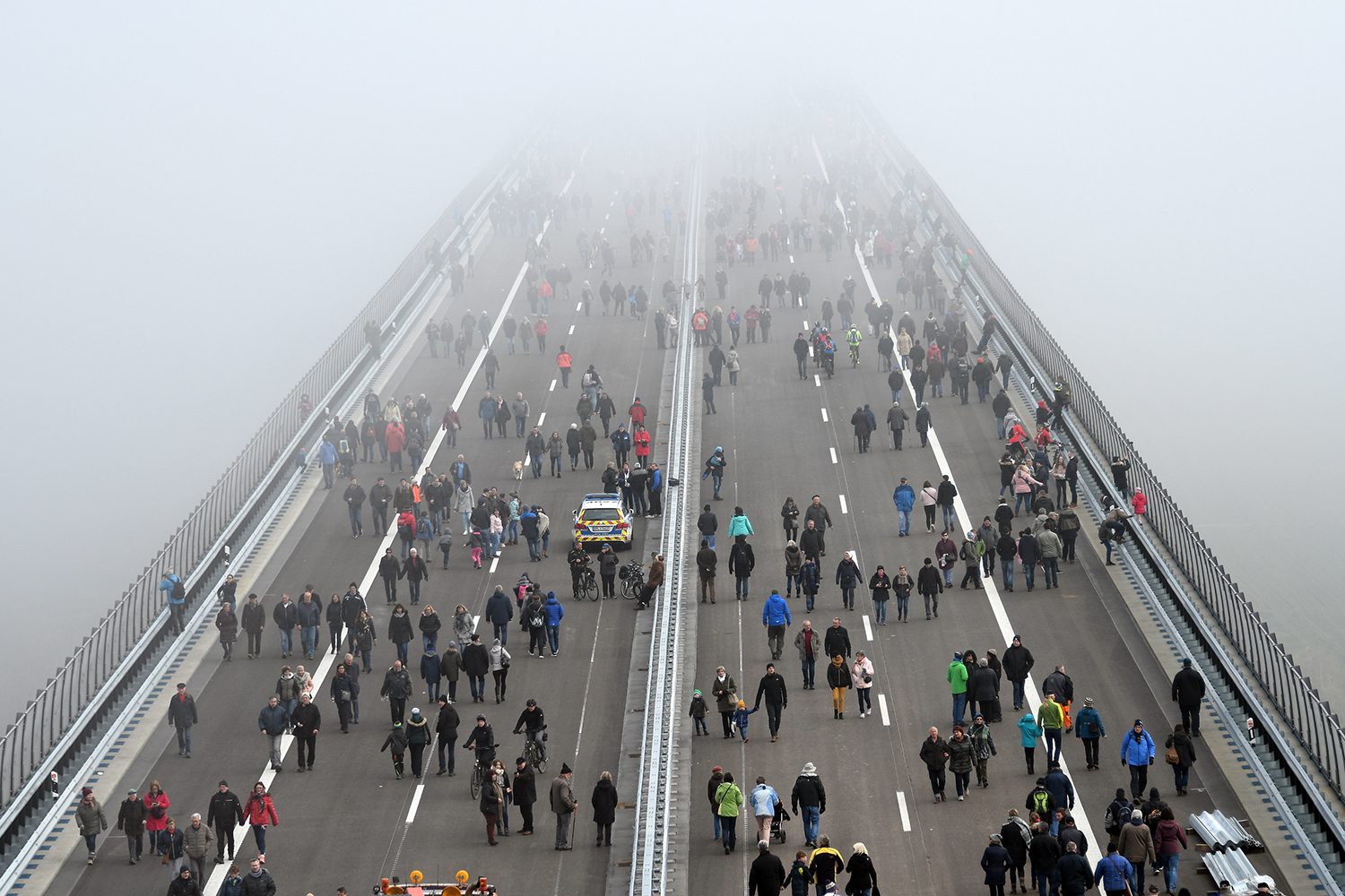 People walk on the Hochmosel Bridge ahead its opening after eight years of construction in Zeltingen-Rachtig, Germany, on Nov. 16. HARALD TITTEL/dpa/AFP via Getty Images