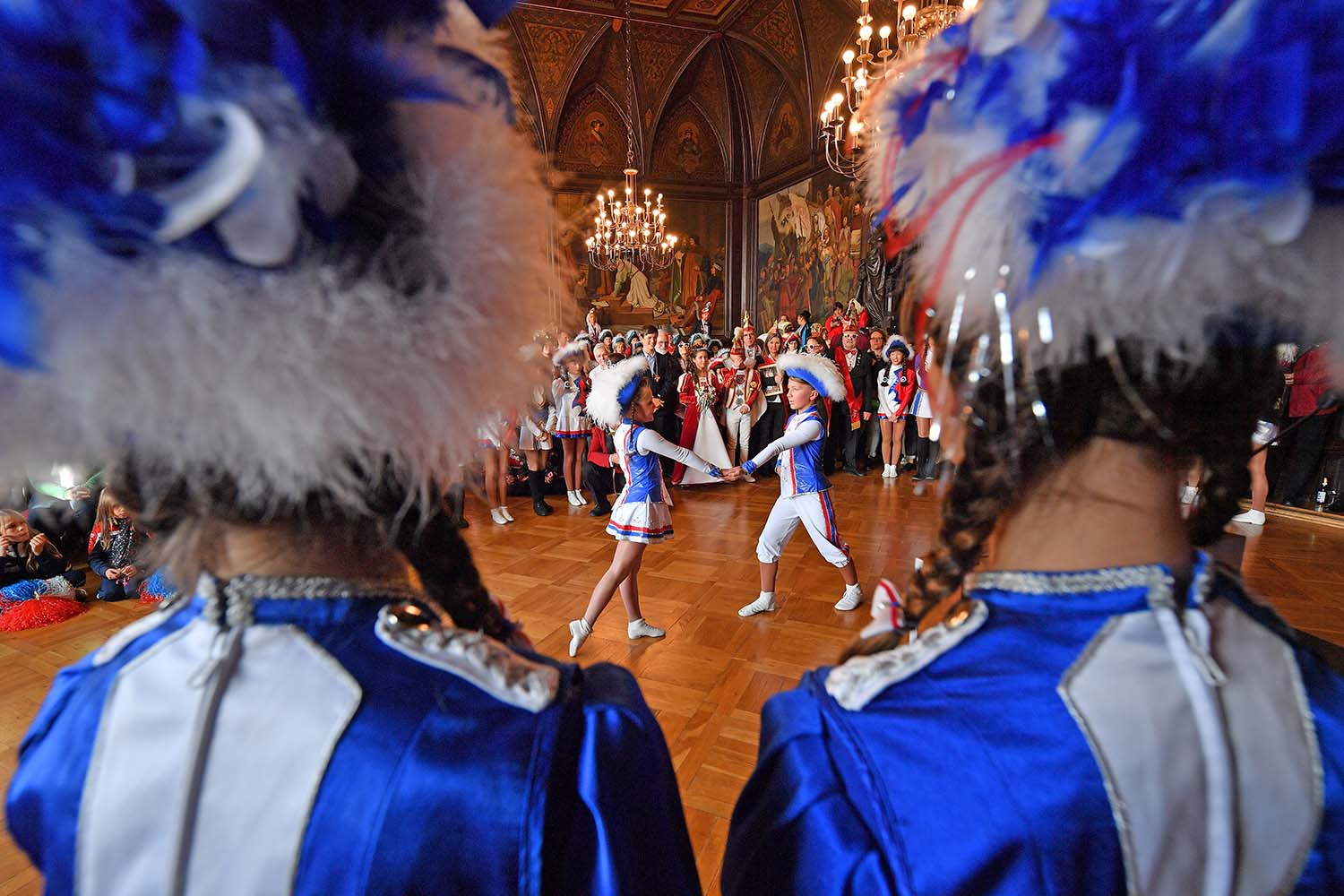 Young members of a dance group perform during an event to celebrate the start of the carnival season at the city hall in Erfurt, eastern Germany, on Nov. 11. MARTIN SCHUTT/DPA/AFP via Getty Images