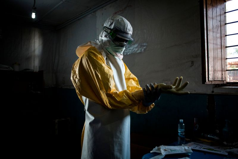 A health worker puts on his personal protective equipment before entering the red zone of a MSF (Doctors Without Birders) supported Ebola Treatment Centre (ETC), where he will check up on patients on Nov. 6, 2018 in Bunia, Democratic Republic of the Congo.