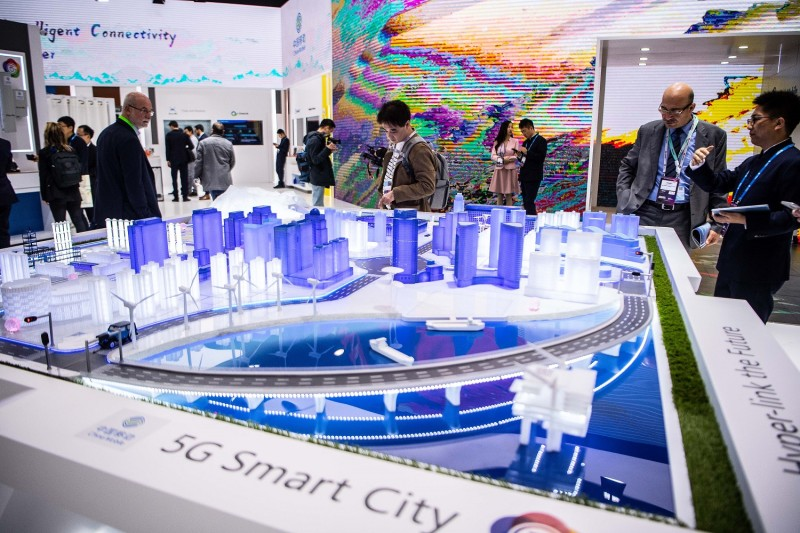 Visitors check out 5G smart city technology at the China Mobile booth