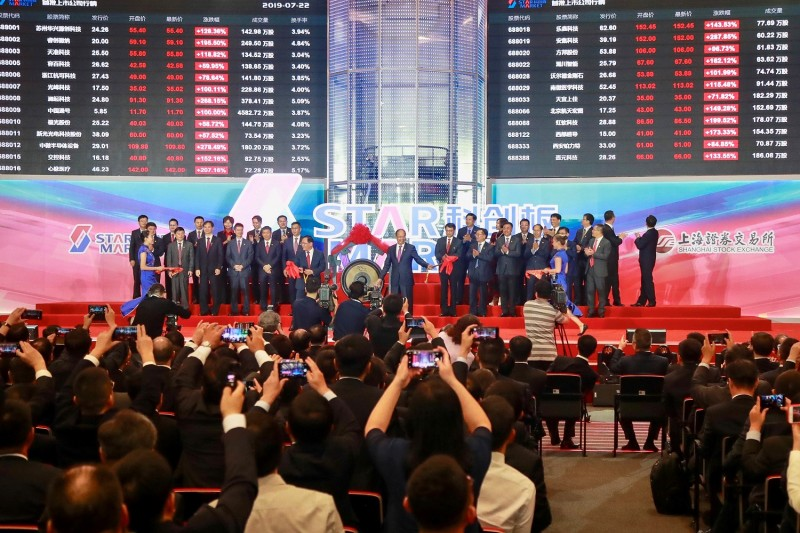 People take pictures during the opening ceremony for the Shanghai Stock Exchange's Sci-Tech Innovation Board in Shanghai on July 22, 2019.