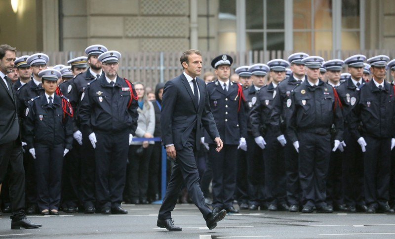 French President Emmanuel Macron and French Interior Minister Christophe Castaner take part in a ceremony at The Prefecture de Police de Paris (Paris Police Headquarters) in Paris on Oct. 8, held to pay respects to the victims of an attack at the prefecture.