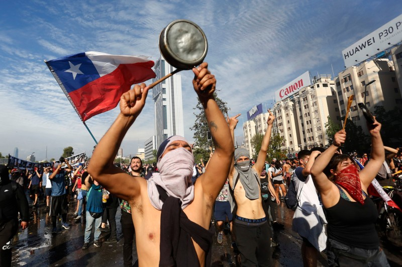 Demonstrators protest against President Sebastián Piñera's economic policies in Santiago, Chile, on Oct. 21.