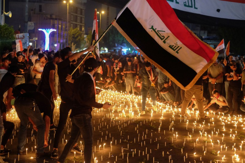 Iraqi protesters hold a candlelight vigil for those killed during anti-government demonstrations in Karbala, south of Baghdad, on Nov. 1.