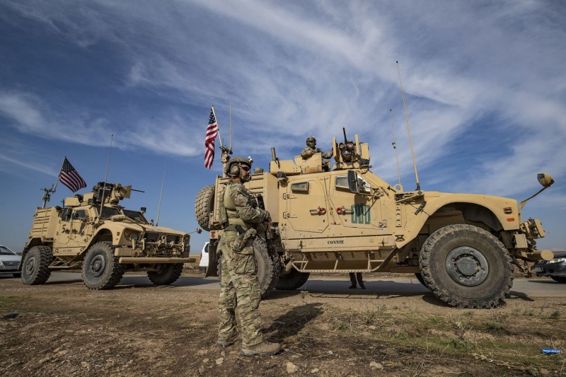 A convoy of U.S. armored vehicles patrols the northern countryside of the northeastern Syrian town of al-Malikiyah at the border with Turkey, on Nov. 3, 2019.