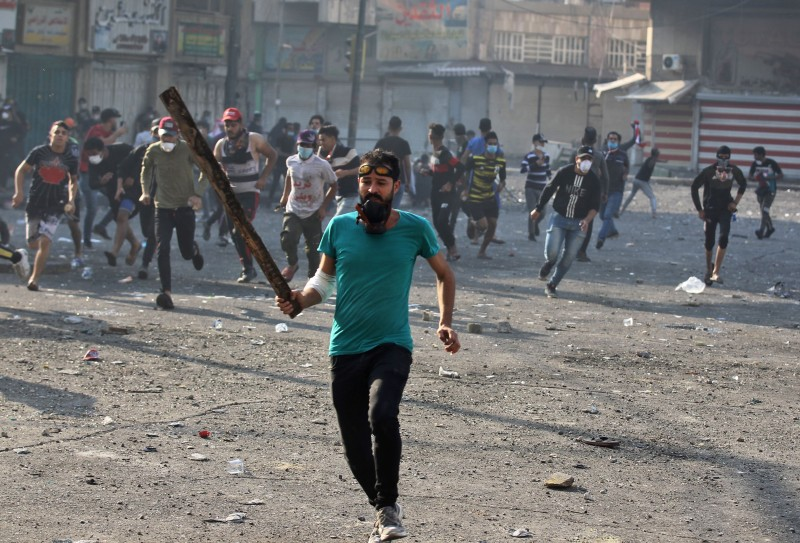 Iraqi protesters clash with security forces at Baghdad's Khallani Square during ongoing anti-government demonstrations on Nov. 11.
