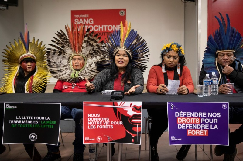 Indigenous leaders listen to Sonia Guajajara, the head of Brazil's Indigenous People Articulation, as she speaks during a press conference on November 12 in Paris, as part of a tour calling on EU lawmakers to exert pressure on the Brazilian government to better protect the rights of indigenous communities, and scrutinize companies profiting from deforestation in the Amazon.