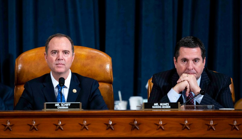 Committee Chairman Rep. Adam Schiff (D-CA) and Ranking Member Rep. Devin Nunes (R-CA) listen to Gordon Sondland, the U.S ambassador to the European Union, testify before the House Intelligence Committee on Capitol Hill in Washington on Nov. 20.
