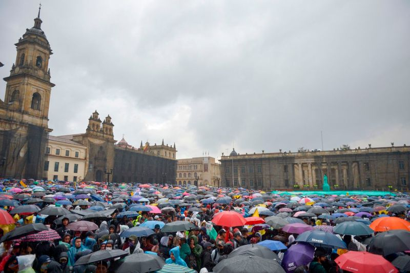 People demonstrate under pouring rain in Bogotá on Nov. 21.