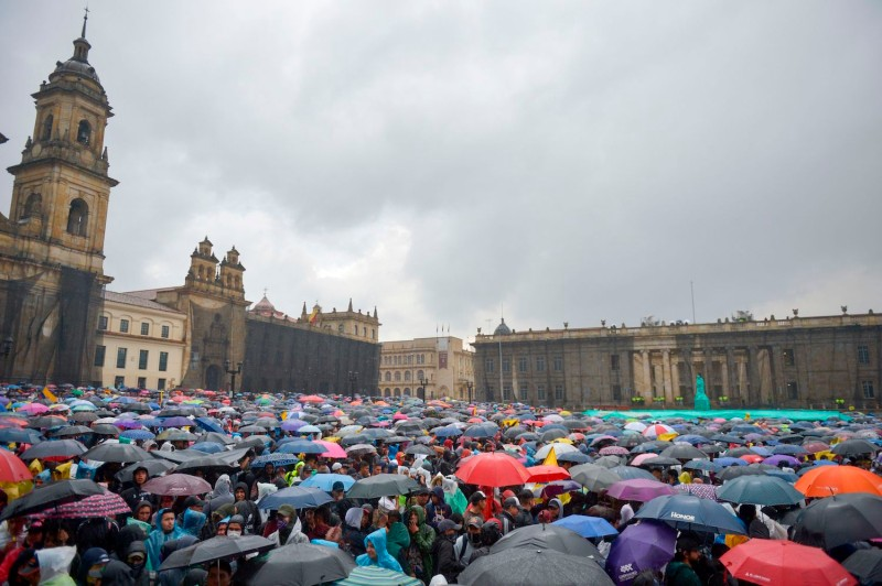 People demonstrate under pouring rain in Bogotá on Nov. 21.