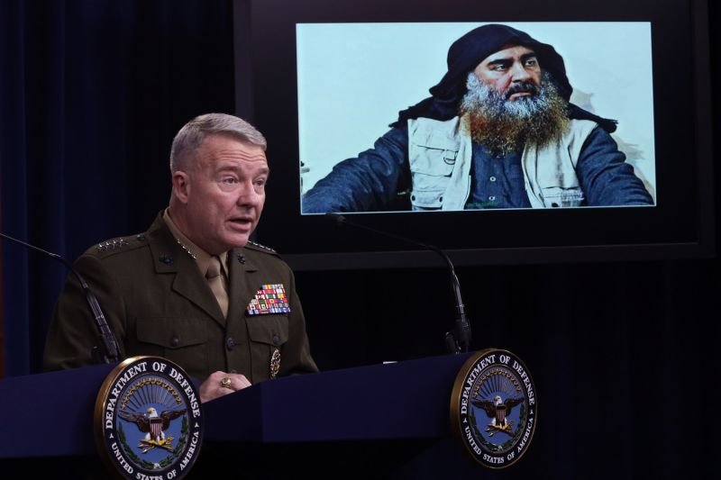 U.S. Marine Corps Gen. Kenneth McKenzie, the head of U.S. Central Command, speaks as a picture of Islamic State leader Abu Bakr al-Baghdadi is seen during a press briefing at the Pentagon in Arlington, Virginia, on Oct. 30.