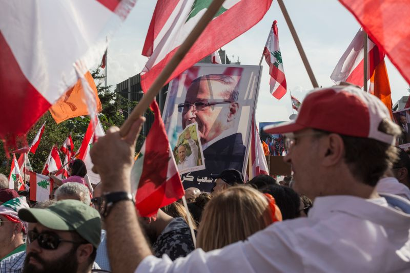 Supporters of Lebanese President Michel Aoun hold posters of him as they gather near the presidential palace in Baabda on Nov. 3.