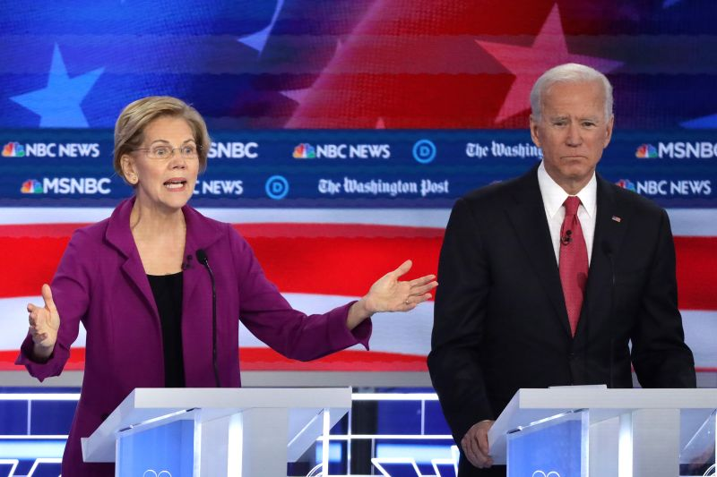 Sen. Elizabeth Warren speaks as former Vice President Joe Biden listens