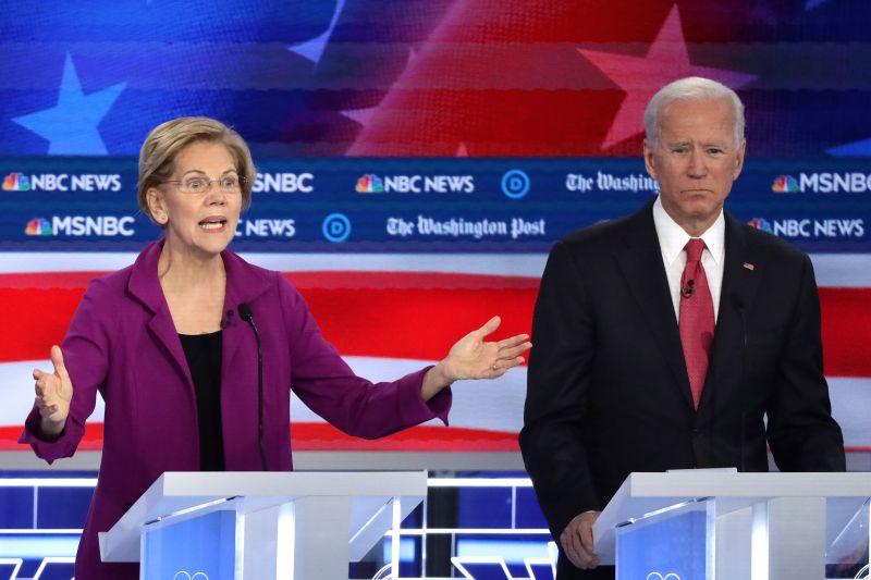 Sen. Elizabeth Warren speaks as former Vice President Joe Biden listens