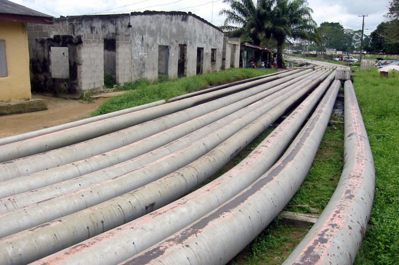 Oil pipelines are seen running through Okrika, a town in the Niger River delta in Nigeria, on Oct. 4, 2004.