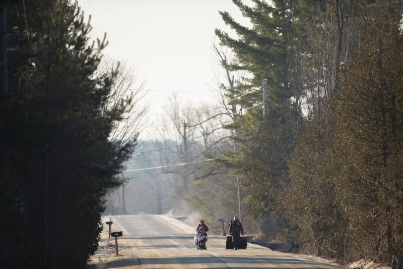 A family from Pakistan walks down Roxham Road in Champlain New York towards the U.S.-Canadian border on Feb. 28, 2017.