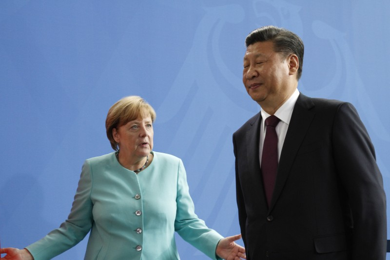 German Chancellor Angela Merkel and Chinese President Xi Jinping speak to the press in Berlin on July 5, 2017.