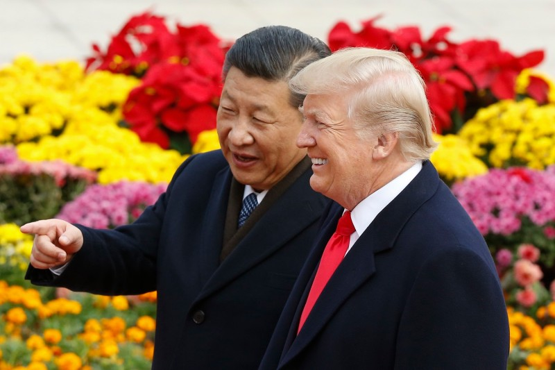 Chinese President Xi Jinping and U.S. President Donald Trump attend a welcoming ceremony in Beijing on Nov. 9, 2017.
