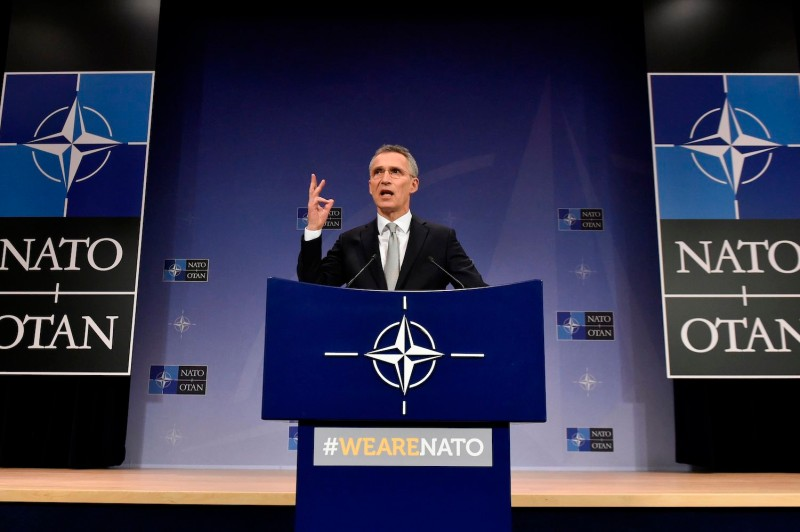 NATO Secretary-General Jens Stoltenberg gestures during a speech at NATO headquarters in Brussels on Feb. 15, 2018.