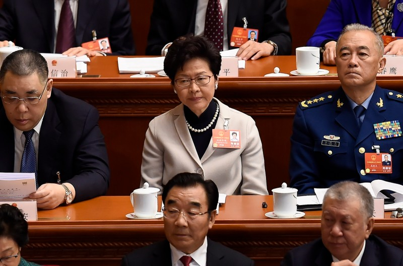 Hong Kong's chief executive, Carrie Lam, attends the opening session of the National People's Congress in Beijing's Great Hall of the People on March 5, 2018.