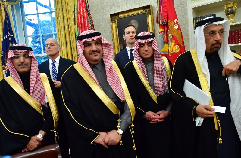 White House Chief of Staff John Kelly, back left, and White House advisor Jared Kushner, back right, stand with members of a Saudi delegation