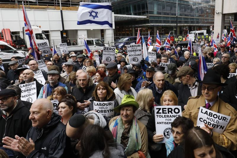 A crowd gathering for a demonstration organized by the Campaign Against Antisemitism outside the head office of the British opposition Labour Party