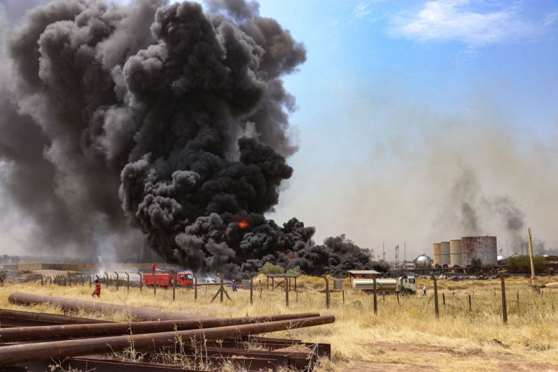 Smoke billows from a fire that broke out at the North Oil Company installations in the disputed oil-rich province of Kirkuk, north of Baghdad, on Aug. 29.