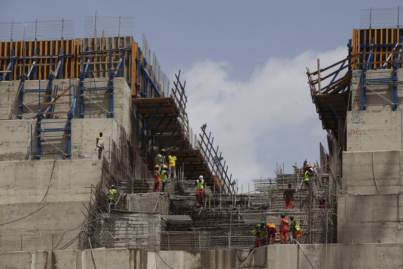 Ethiopian builders work on the Grand Ethiopian Renaissance Dam near the Sudanese-Ethiopian border on March 31, 2015.