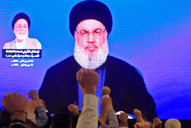 Supporters of Hassan Nasrallah, the head of Lebanon's militant Shiite Muslim Hezbollah movement, watch him speak through a giant screen at a mosque in Beirut on Nov. 1.