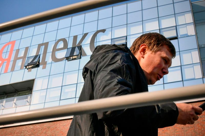 A man walks outside the headquarters of Yandex in Moscow on Oct. 19, 2018.