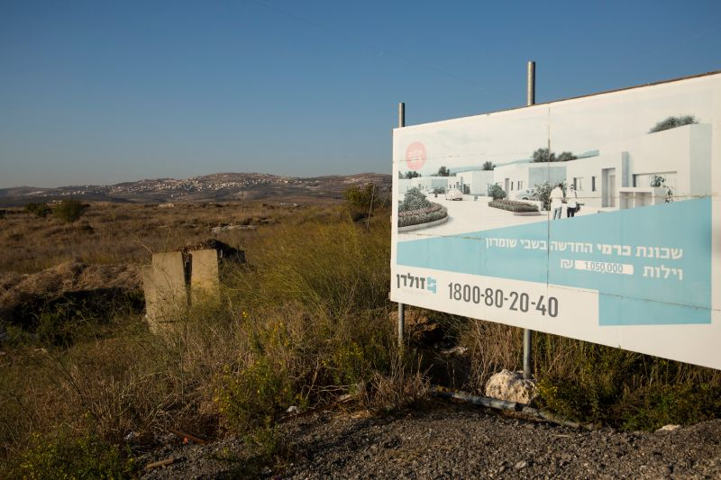 A sign shows a new neighborhood project near the Israeli settlement of Shavei Shomron on Nov. 19.
