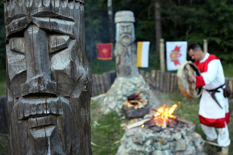 A shaman is pictured behind a fire during a traditional Slavic holiday celebration in the Kalugskaya region of Russia on June 22, 2008.