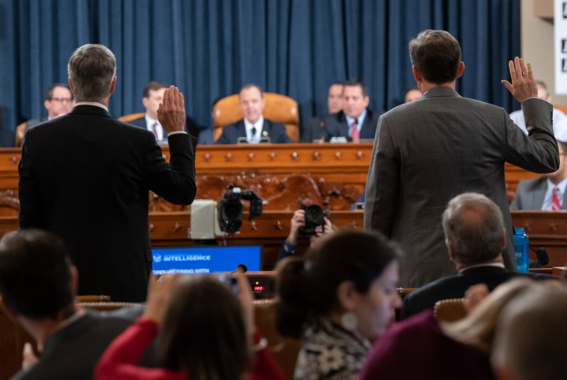 Top U.S. diplomat in Ukraine William Taylor and Deputy Assistant Secretary for European and Eurasian Affairs George Kent are sworn in prior to testifying before the House Intelligence Committee in Washington on Nov. 13.