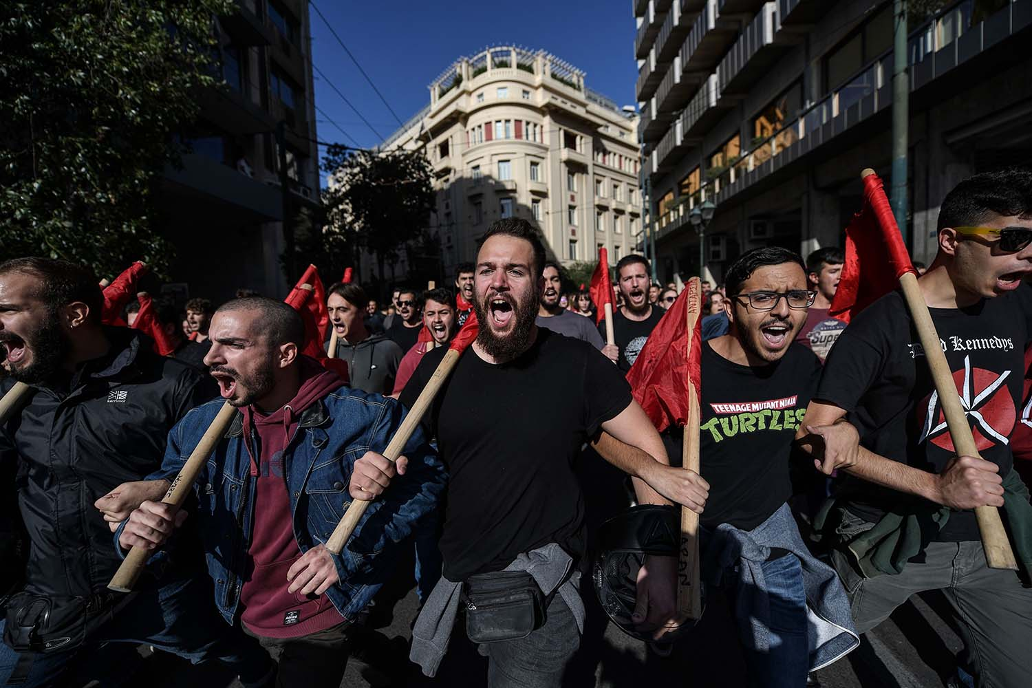 Students shout slogans as they demonstrate against recent educational reforms including the University Asylum law, in central Athens, Greece, on Nov. 14. ARIS MESSINIS/AFP via Getty Images