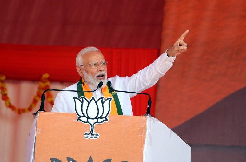 Prime Minister Narendra Modi speaks during a rally at Mallekan village, in Ellenabad, India on Oct. 19.
