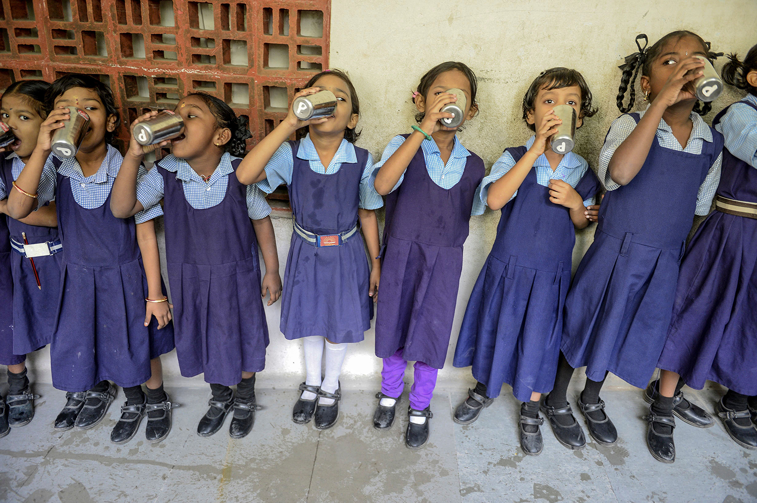 Schoolchildren drink water during the Water Bell program launched by Telangana government, to ensure children drink sufficient water in the day, at a government-run school in Secunderabad, India, on Nov. 21. NOAH SEELAM/AFP via Getty Images