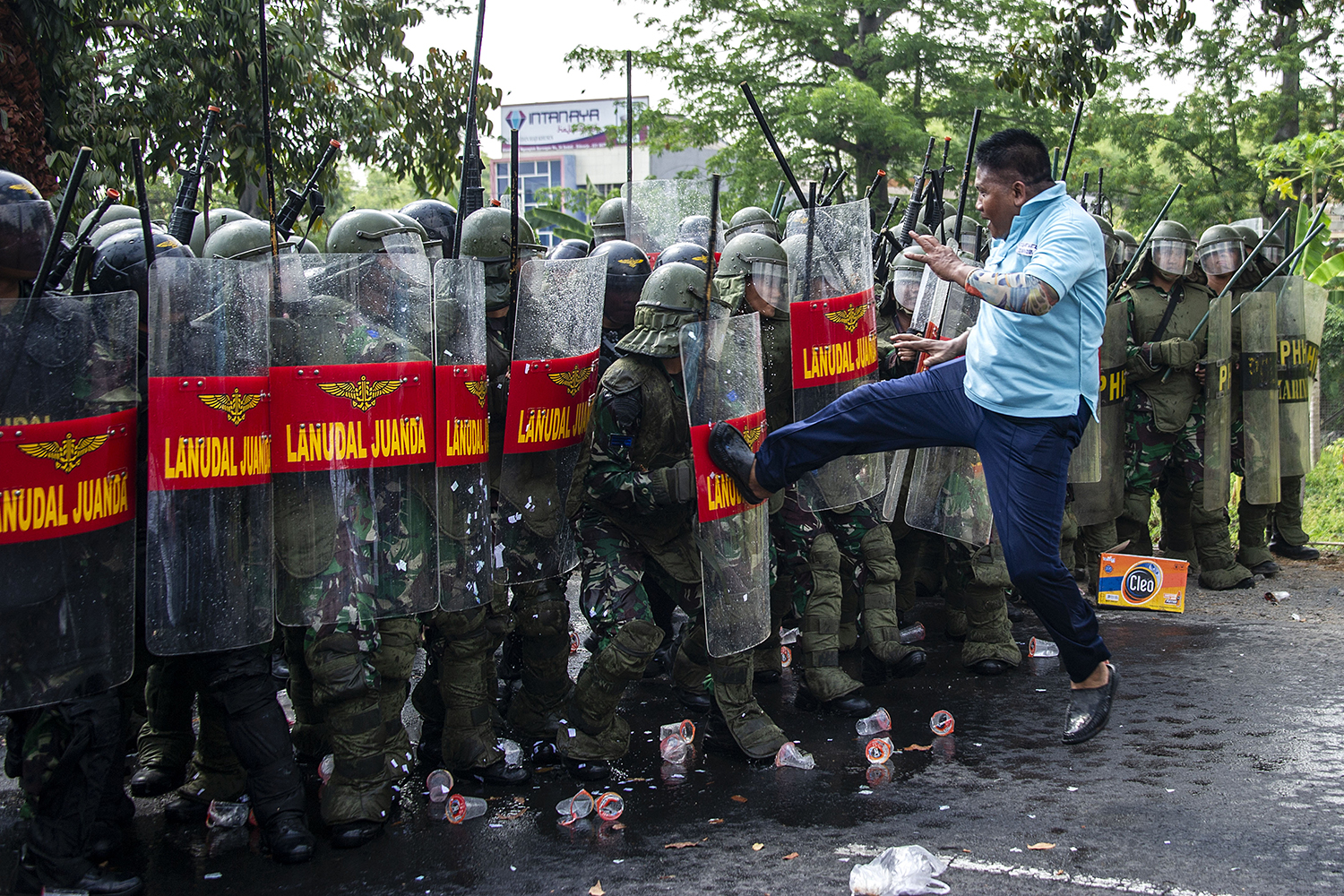 A member of the military playing the role of protester challenges a line of Indonesian Navy frogmen and commandos during an anti-terror drill to sharpen their skills in Sidoarjo, East Java, on Nov. 19. JUNI KRISWANTO/AFP via Getty Images