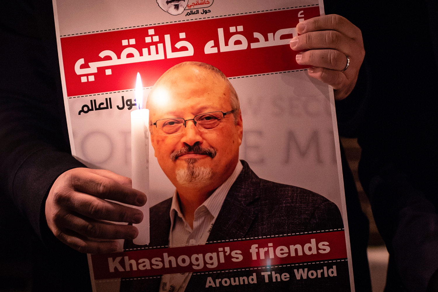 A demonstrator holds a poster of slain journalist Jamal Khashoggi during a gathering outside the Saudi Arabia consulate in Istanbul on Oct. 25, 2018.
