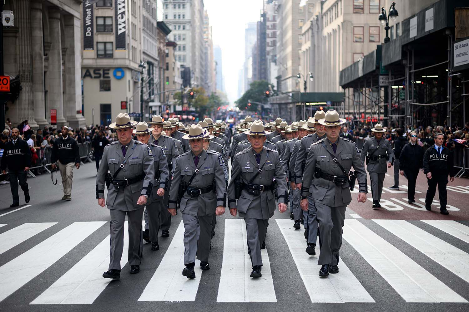 People attend the Veterans Day Parade on Fifth Avenue in New York City on Nov. 11. JOHANNES EISELE/AFP via Getty Images