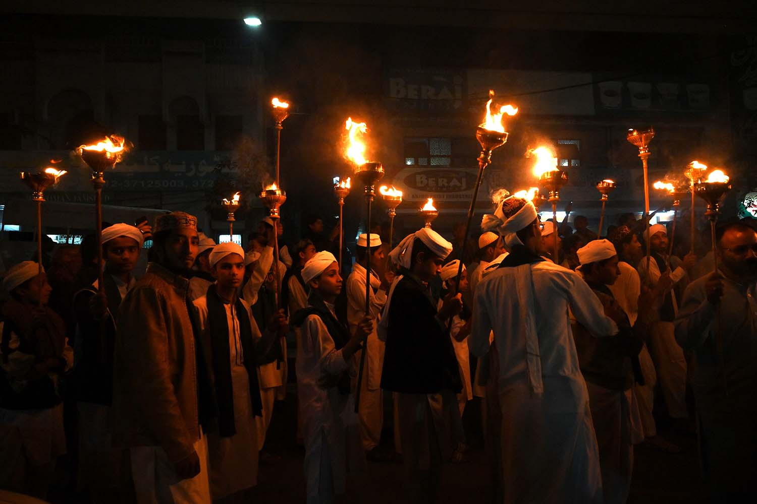 Pakistani children hold torches in a rally to mark the birthday of the Prophet Mohammed in Lahore on Nov. 9. ARIF ALI/AFP via Getty Images