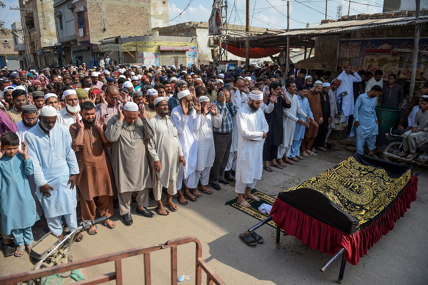 Residents offer a funeral prayer for a train fire victim in Mirpurkhas, Pakistan, on Nov. 1, a day after a passenger train caught on fire in Rahim Yar Khan killing at least 74 people. IZWAN TABASSUM/AFP via Getty Images