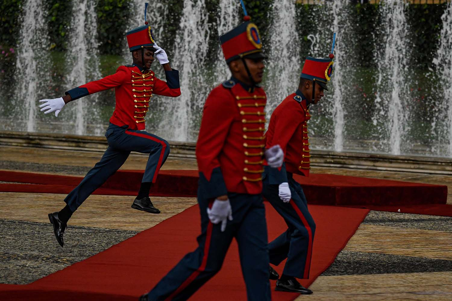 Members of the presidential honor guard walk outside Narino presidential palace before the visit by Panama's President Laurentino Cortizo in Bogota on Nov. 13. JUAN BARRETO/AFP via Getty Images