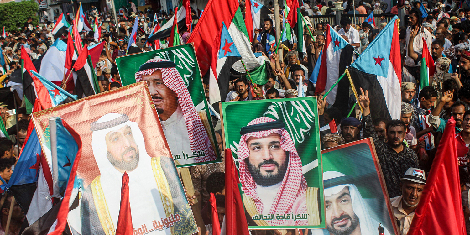 People march with the flags of south Yemen, the United Arab Emirates, and Saudi Arabia, as portraits are raised of Saudi and UAE during a demonstration in Aden on Sept. 5. SALEH AL-OBEIDI/AFP via Getty Images