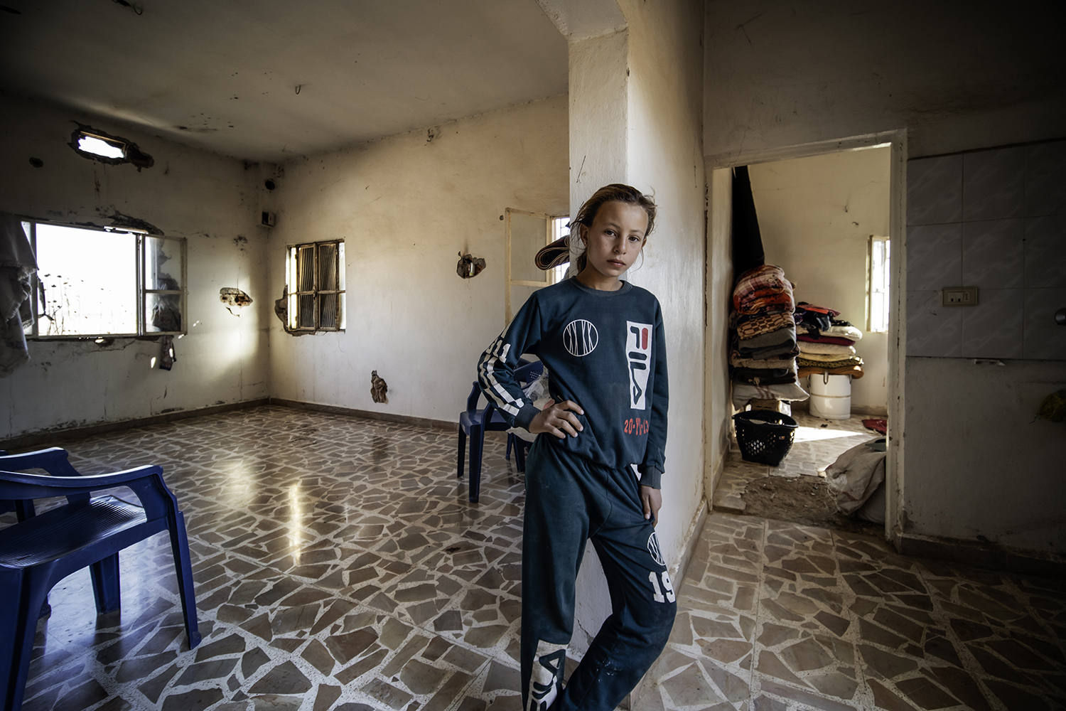 Salem Awyed's 12-year-old daughter stands in her family's new home in the historically Christian village of Tal Hafyan, abandoned during Islamic State rule, on Nov. 9. Most houses show signs of the heavy fighting between Syrian Democratic Forces and the Islamic State.