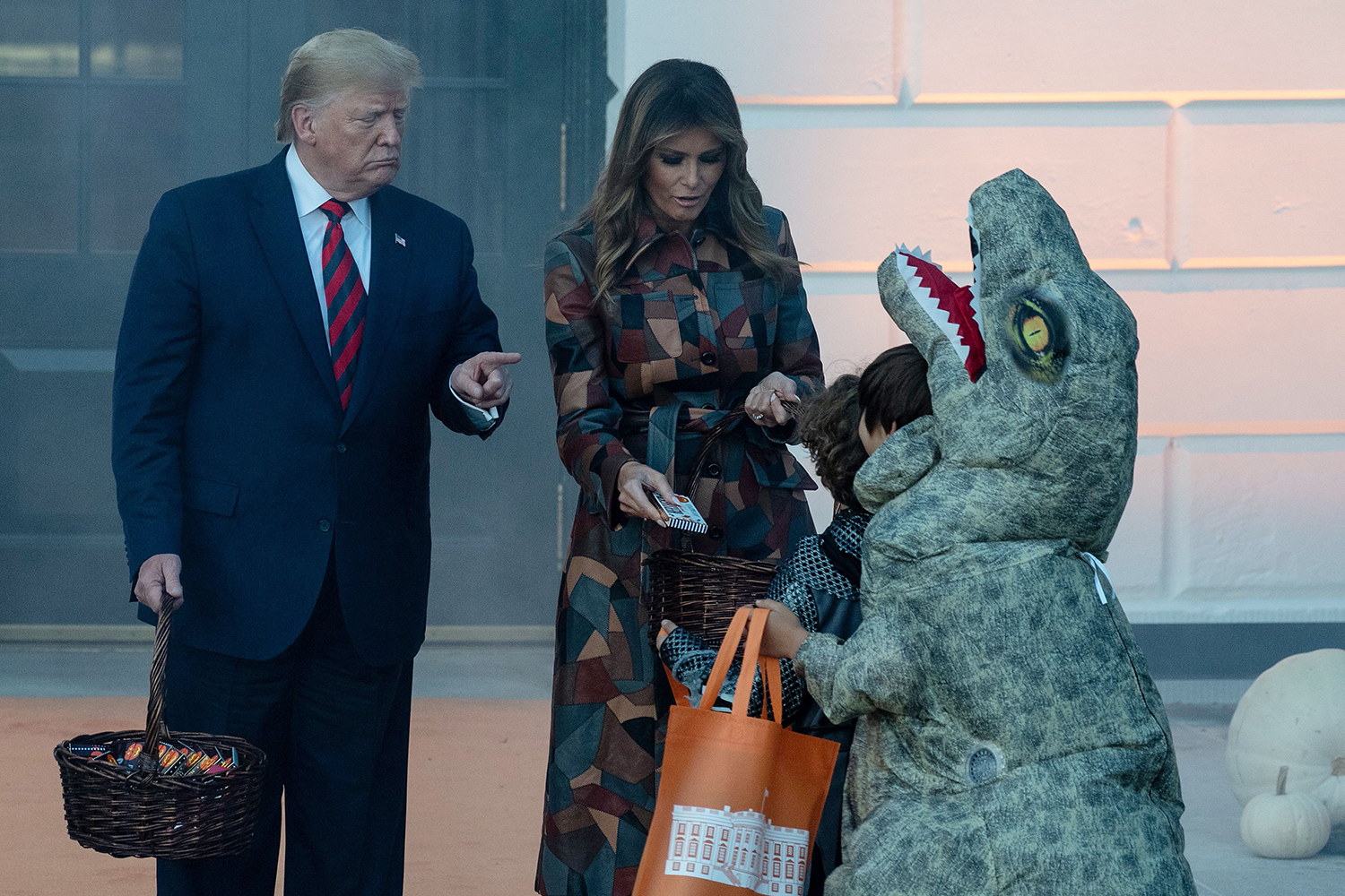 U.S. President Donald Trump and First Lady Melania Trump arrive to hand out candy for children at a Halloween celebration at the White House in Washington on Oct. 28. NICHOLAS KAMM/AFP via Getty Images