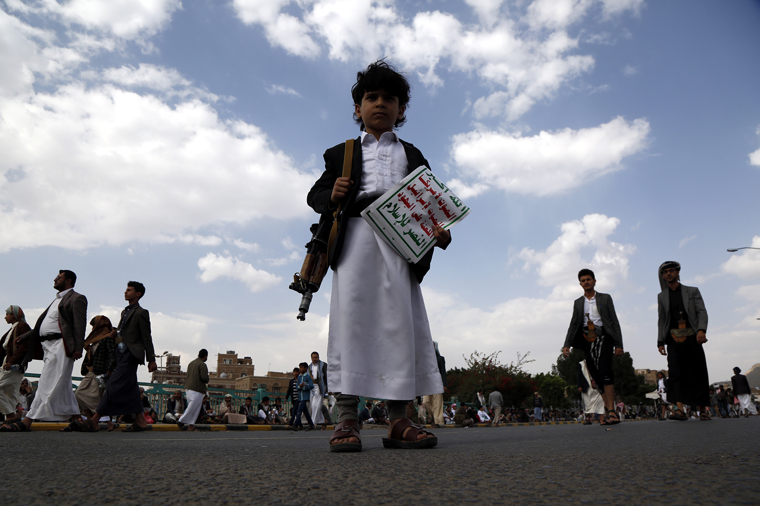 A Yemeni child carries a gun and holds a Houthi flag as he takes part in protest in Sana'a staged against the Saudi-led coalition for preventing the Houthi delegation from traveling to Geneva to attend the U.N.-sponsored peace talks on Sept. 7, 2018.