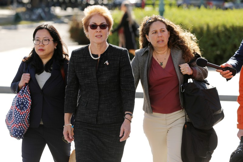 Former U.S. Ambassador to Ukraine Marie Yovanovitch (center) arrives at the U.S. Capitol to testify as part of the ongoing impeachment investigation against President Donald Trump in Washington on Oct. 11.