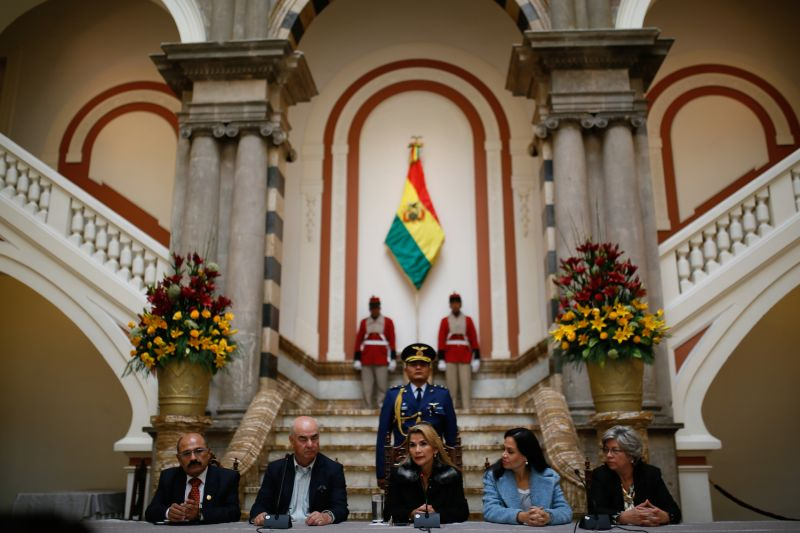Bolivia's interim President Jeanine Áñez (center) speaks during a press conference at the presidential palace.